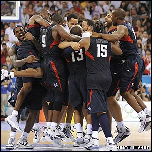 The United States men celebrate winning gold with a 118-107 victory over Spain in the basketball final