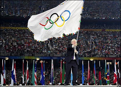 The Mayor of London Boris Johnson waves the Olympic flag
