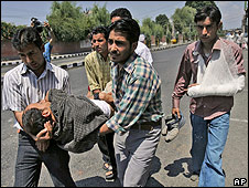 Journalists carry injured colleague