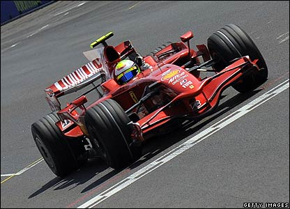 Felipe Massa celebrates as he wins the European Grand Prix