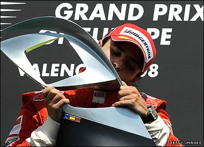 Felipe Massa holds the winner's trophy at the Hungarian Grand Prix