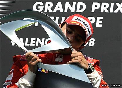 Felipe Massa holds the winner's trophy at the Hungarian Grand Prix