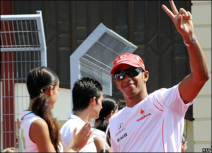 Lewis Hamilton waves to the crowd during the pre-race driver parade at the European Grand Prix