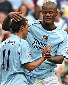 Vincent Kompany congratulates Elano after his second goal of the game