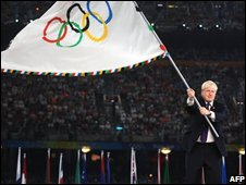 Boris Johnson with the Olympic flag