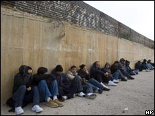 Mexicans waiting on the Mexican side of the US border