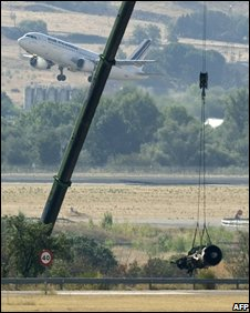 Part of a jet engine beloning to the Spanair MD 82 aircraft  that crashed in Madrid is recovered