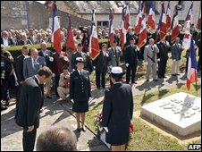 French President Nicolas Sarkozy pays tribute to the victims of the Maille massacre