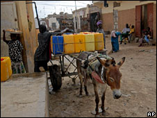 Man delivers water on donkey-drawn cart