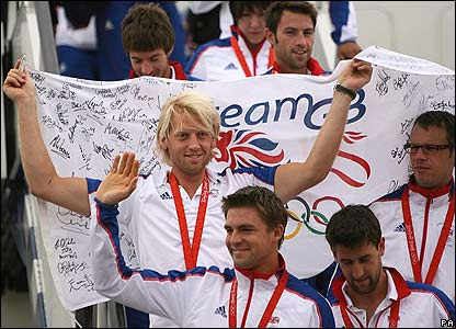 Some of Team GB's rowers emerge from the aircraft