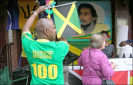 A man wearing a Usain Bolt T-shirt