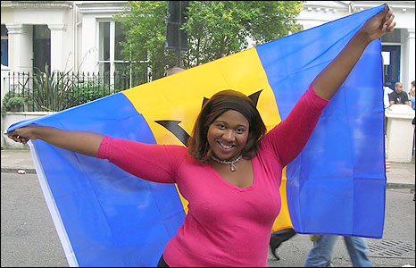 Tanya carrying a Barbados flag