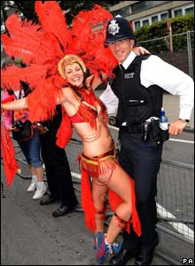 Dancer and police officer at the Notting Hill Carnival