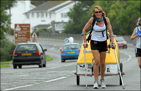 Rosie Swale Pope pulls her trailer on the last mile of her 20,000 mile trek