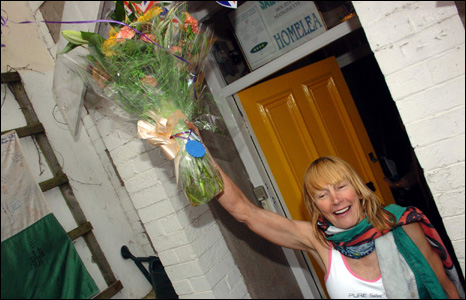 Home at last Rosie Swale Pope with a bouquet of flowers on her doorstep in Tenby