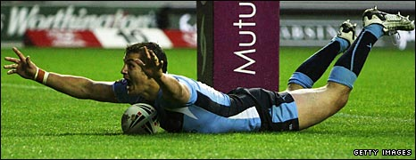 Jon Wilkin dives in for a try underneath the posts