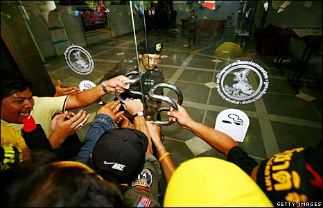 Thai anti-government protesters break into the studio of state broadcaster National  Broadcasting Services of Thailand, 26 August, 2008