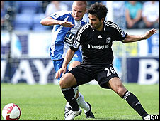 Wigan's Lee Cattermole (left) closes down Chelsea's Deco