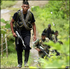 Photo released by Colombia's Peace Commissioner's Office shows rebels walking to hand in their arms