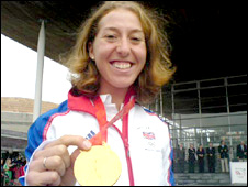 Nicole Cooke shows off her gold medal