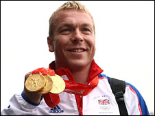 Chris Hoy with his three Olympic gold medals