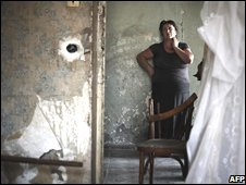 A woman stands in her house destroyed by a Russian bombing in Gori, Georgia, 25 August, 2008