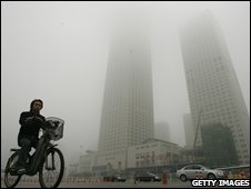 Cyclist in front of fog-shrouded skyscrapers 2007