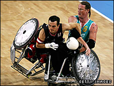 David Willsie of Canada is upended by Brad Dubberley of Australia at the 2004 Paralympics