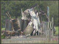 Burnt barrels and other debris