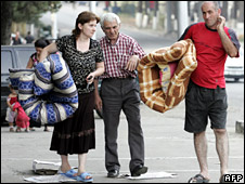 Ethnic Georgians from South Ossetia carry mattresses at a refugee centre in Tbilisi  (25 August 2008)
