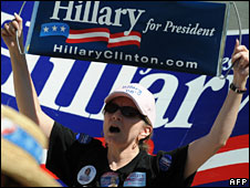 A supporter marches for Hillary Clinton in Denver, 26 Aug