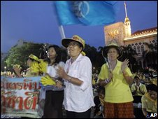Thai demonstrators wave flags as they occupy Government House Wednesday, Aug 27