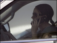 woman in car using phone