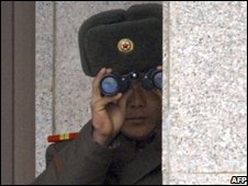A North Korean soldier looks at the southern side across the demilitarised zone, 2006