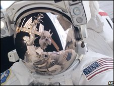 Astronaut doing spacewalk, AP