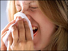 Woman sneezing