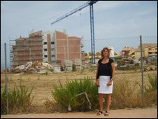 Inez Rix beside building site