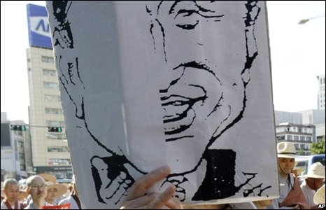 Protester holds up caricature picture of President Lee