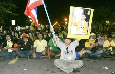 Thai demonstrators sit outside Government House, Wednesday, Aug 27