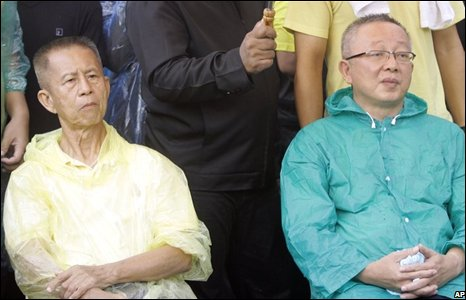 Leaders of Thai demonstrators Chamlong Srimuang, left, and Sondhi Limthongkul, right, sit during a demonstration