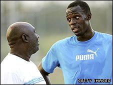 Usain Bolt (right) and coach Glen Mills