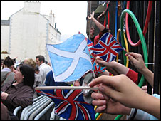 Royal Mile Primary School pupils wave flags during the parade