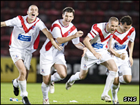 Airdrie players celebrate after their shoot-out win