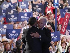 Barack Obama and Joe Biden embrace on stage, 27 Aug 2008
