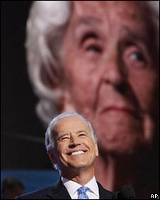 Joe Biden on stage with his mother, Joan Biden, shown on screen behind, 27 Aug