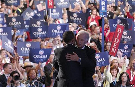 Barack Obama and Joe Biden embrace on stage at the convention, 27 Aug