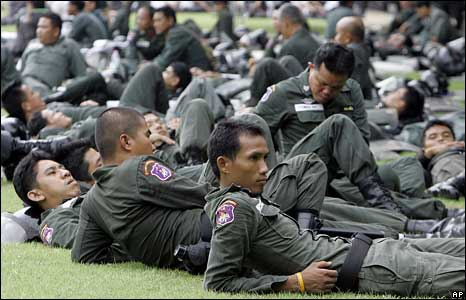 Thai soldiers rest near Government House in Bangkok on Thursday