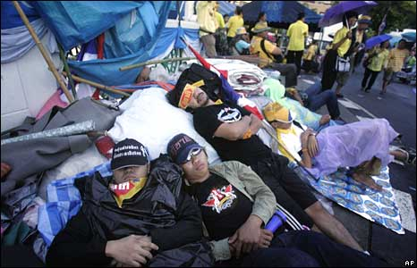 Occupying protesters sleep in the grounds of Government House, Bangkok, on Thursday
