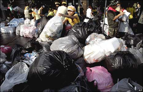 Demonstrators pile up rubbish bags in Government House, Bangkok on Thursday