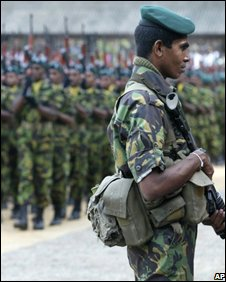 Sri Lankan troops parade at a passing out ceremony near Colombo